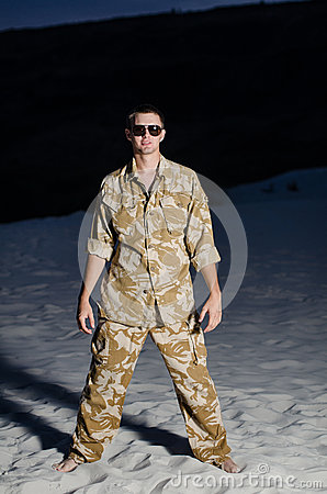 Man in uniform on the beach