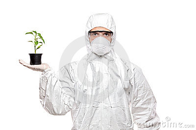 A man in uniform holding a plant