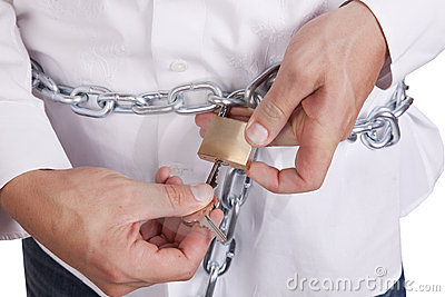 Man unlocking chain