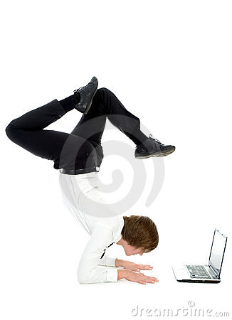 Man upside down using laptop