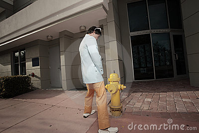 Man urinating on a fire hydrant