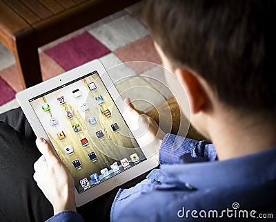 Man using ipad Editorial Stock Photo