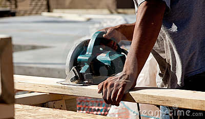 Man using circular saw on wood