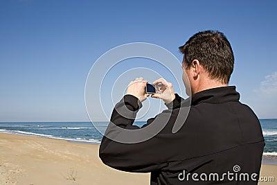 Man using compact camera