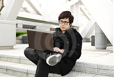 Man using computer outdoor