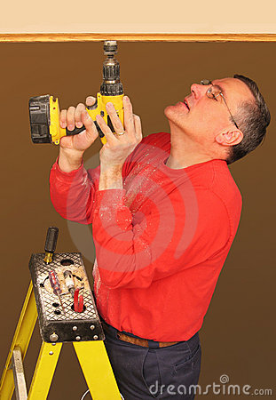 Man using cordless electric drill