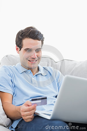 Man using his credit card to buy online