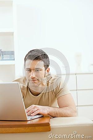 Free Man Using Laptop At Home Royalty Free Stock Images - 10131649