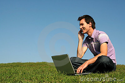 Man using a laptop outdoors