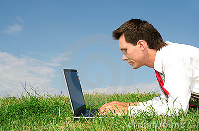 Man using laptop outdoors