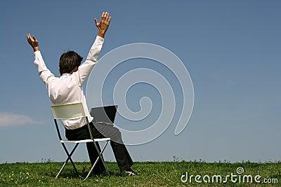 Man using laptop outdoors