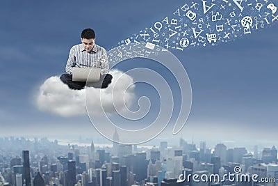 Man using laptop over cloud