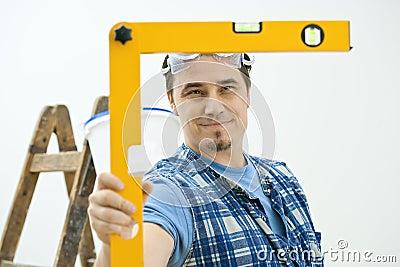 Man using level tool