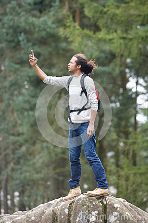 Free Man Using Mobile Phone Whilst Hiking In Countryside Royalty Free Stock Photos - 33924688