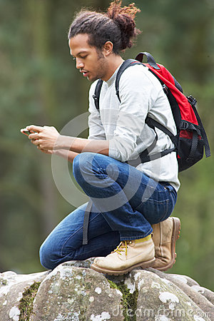 Free Man Using Mobile Phone Whilst Hiking In Countryside Royalty Free Stock Photo - 34177775