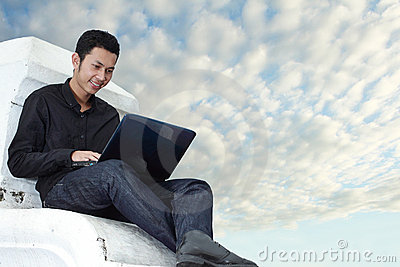 Man using notebook outdoors
