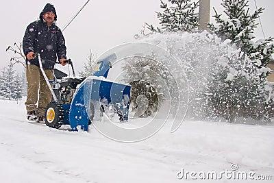 Man using a powerful snow blower