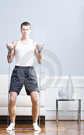 Man Using Resistance Bands in Living Room