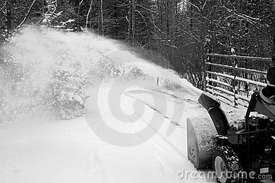 Man using Snow Blower in Driveway