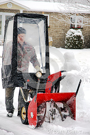 Man using snowblower