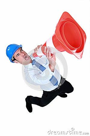 Man using a traffic cone