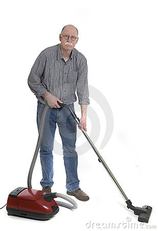 Man is using a vacuum cleaner