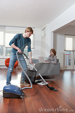 Man Vacuum Cleaning Woman Working Stock Photography Image 7823632