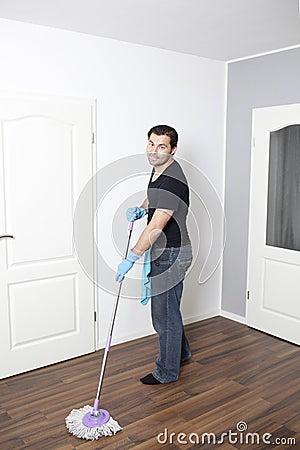 Man vacuums flat