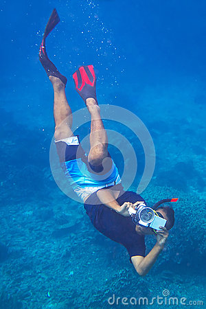 Man with video camera underwater Editorial Photo