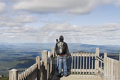 Man on viewpoint admiring landscape