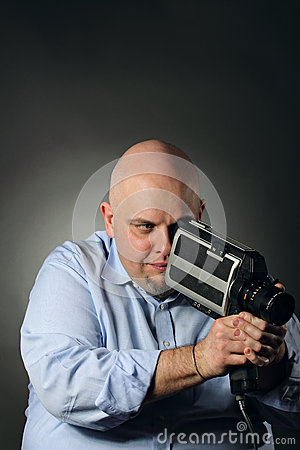 Man with vintage videocamera