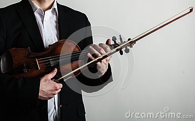 Man violinist holding violin. Classical music art Stock Photo