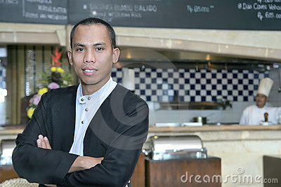 Man in waiter uniform at work