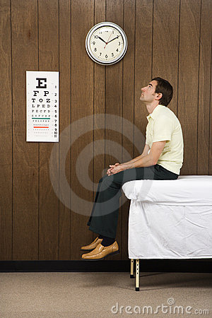 Man waiting in retro doctor s office.
