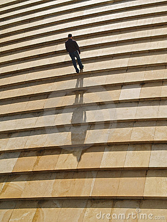 Man walking alone upstairs