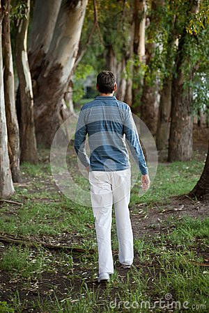 Man Walking Alone in Woods