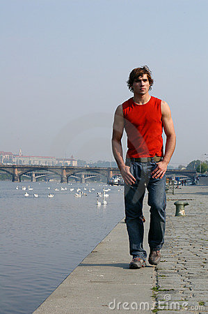 Man Walking Along the Embankment