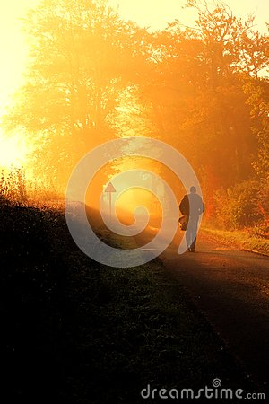 Man walking on an autumn morning.