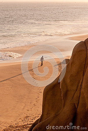 Man walking on beach alone