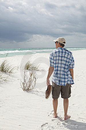 Man walking on beautiful pristine beach