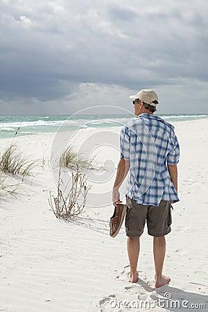 Man walking on beautiful pristine beach
