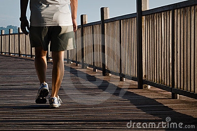 Man walking on boardwalk