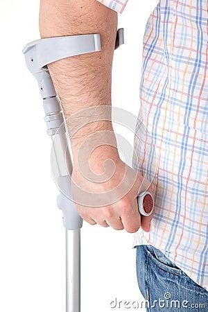 Man walking with a crutch