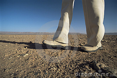 Man walking in desert, low section
