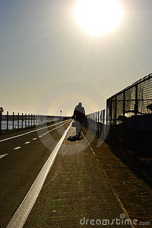 Man walking down the boardwalk