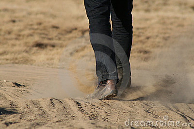 Man walking through dust