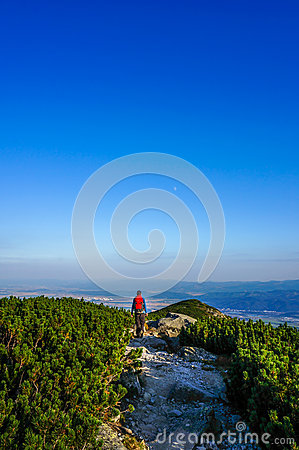 Man walking forward on a mountain tourist path