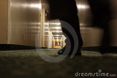 Man walking in hallway
