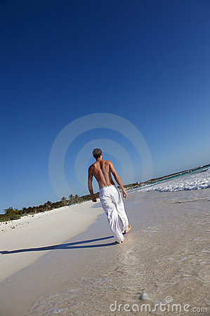 Man walking on idyllic beach