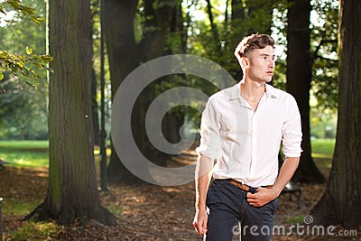 Man walking in the park at sunrise